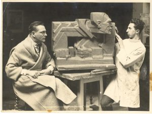 A young Nemon sculpts his teacher Pierre de Soete in 1927, in a Cubist-influenced style.