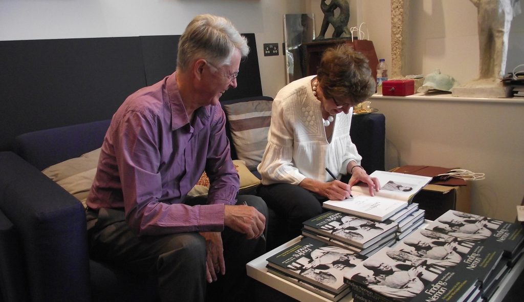 Aurelia Young and Julian Hale sign copies of 'Finding Nemon' together at the launch of the new biography.